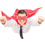 Superhero with red cape flying isolated on white background
